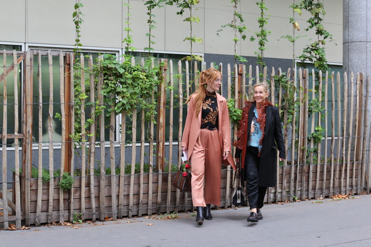 Mother & daughter at work during Paris Fashion Week